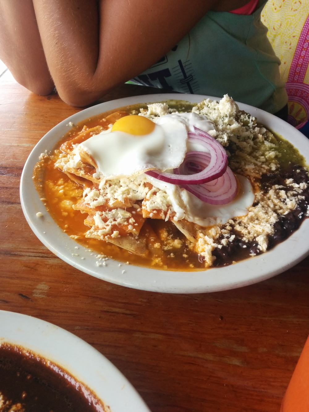 Chilaquiles. Famous for its curative hangover properties. Take day old tortillas, cut into triangles, fry them and serve them in red or green salsa. Top with egg and cheese. ....I can't look at this anymore.
