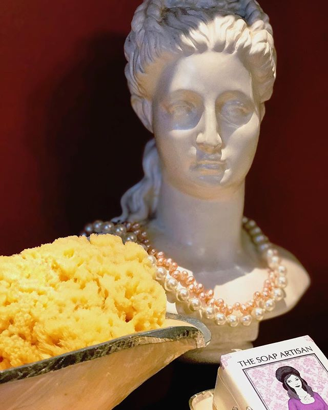 🌜One of our proud ladies sits quietly and poised in our shop. Flanked by our #AllNatural Sea Sponges, and #Lavender Soap.🌛The sponges are phenomenal, gentle exfoliating tools. #Exfoliating every few days will help your skin shed old skin cells, allowing for your facial oil to be absorbed to a maximum benefit. These sponges are a gift from mother nature's ocean, and are soft and creamy when paired with any of our soaps. Try one and see for yourself, we are sure you'll love it 😉😃☀️