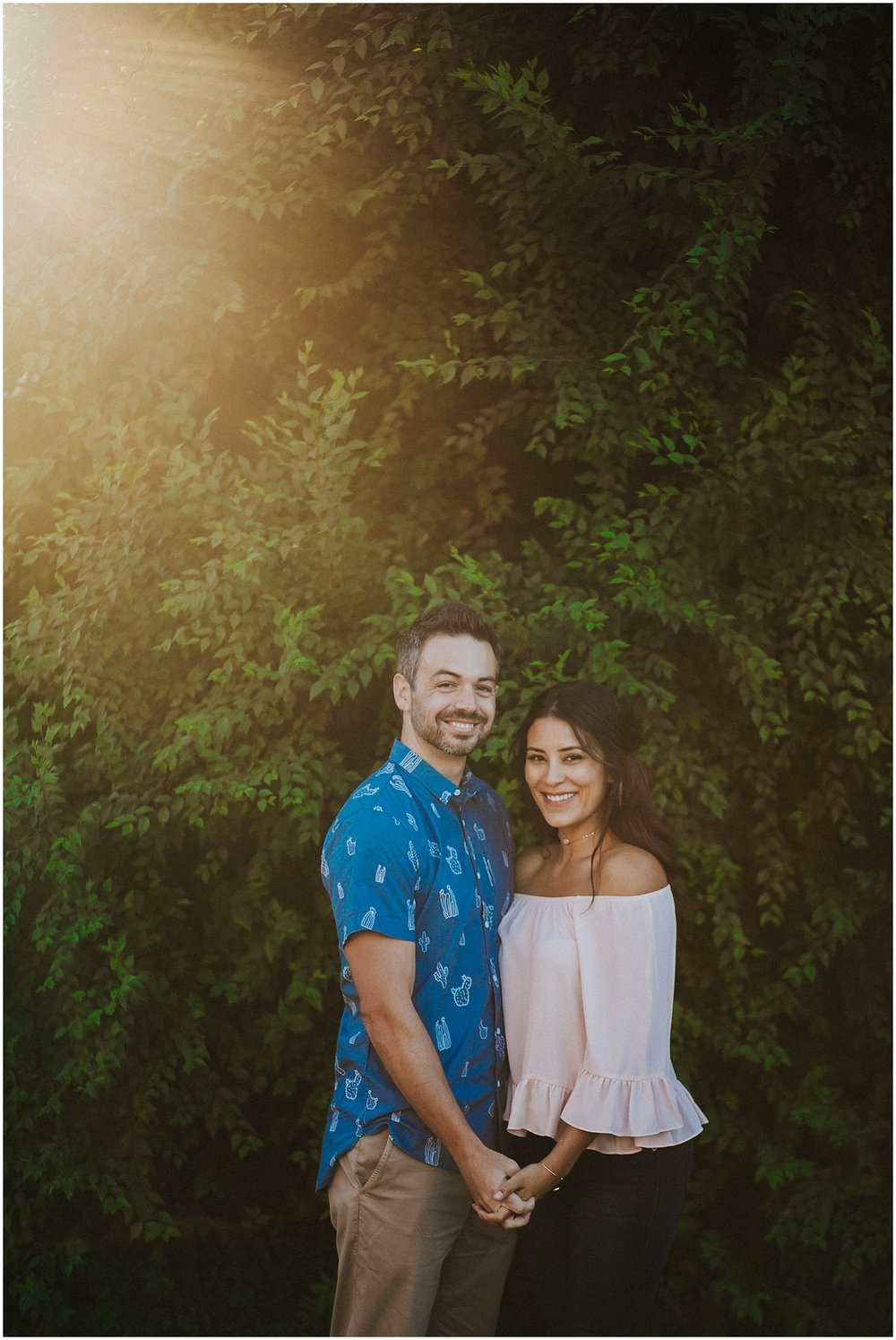 I met Jade and Steve on an early summer morning on Bent Street in Taos, New Mexico. Jade and Steve dressed in the cutest engagement photo outfits I have ever seen. His blue cactus shirt perfectly complimented her blush pink blouse. The beautiful morning light in Taos is unlike any light source I've ever worked with. Their entire engagement photo session was a dream to photograph. We explored throughout Bent Street, checking out the John Dunn Shops, and a little beyond the Taos Plaza, captured some gorgeous New Mexico engagement photos, and then headed to Overland Sheepskin Co. for part two of this rad engagement photo shoot. | Jasper K Photography | New Mexico Engagement Photographer