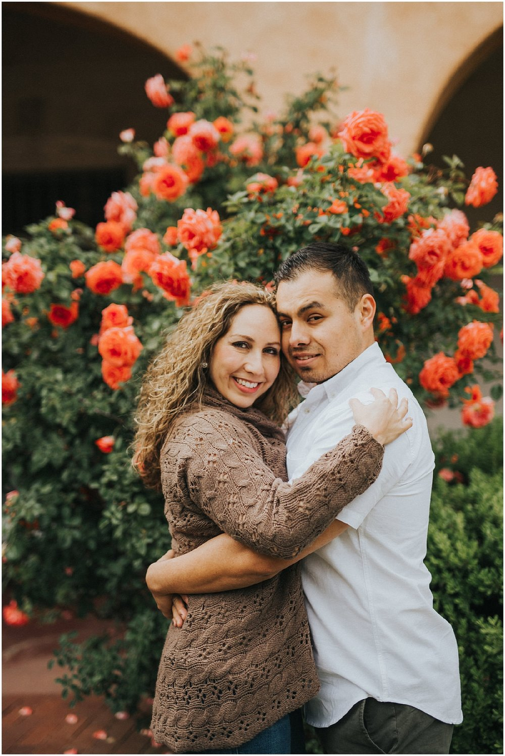 Jacque and Adan traveled from California to New Mexico and I had the honor of capturing some fabulous Albuquerque engagement photos for them while they were here! We explored throughout Old Town Albuquerque on a beautiful spring afternoon. It was true that April showers brings May flowers because the roses were in full bloom which made for some romantic engagement photo inspiration!