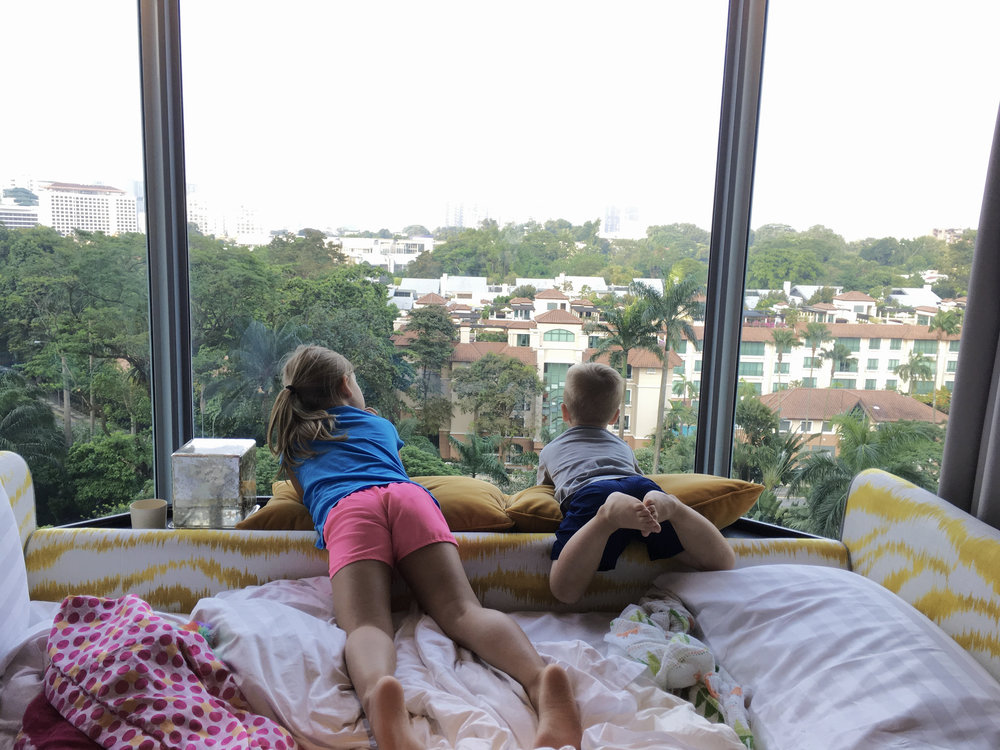 The kiddos are looking out the hotel window at the view!