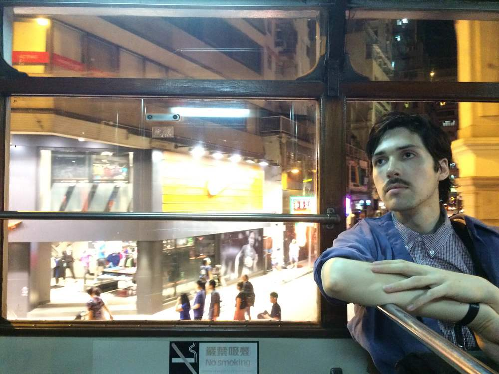 Adam very casually enjoying an evening tram ride.
