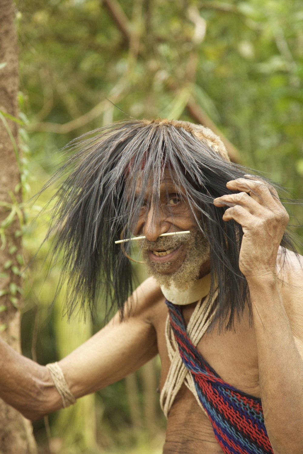 The oldest living Kosua man who will share his colorful stories and song from the bygone era of widespread cannibalism.