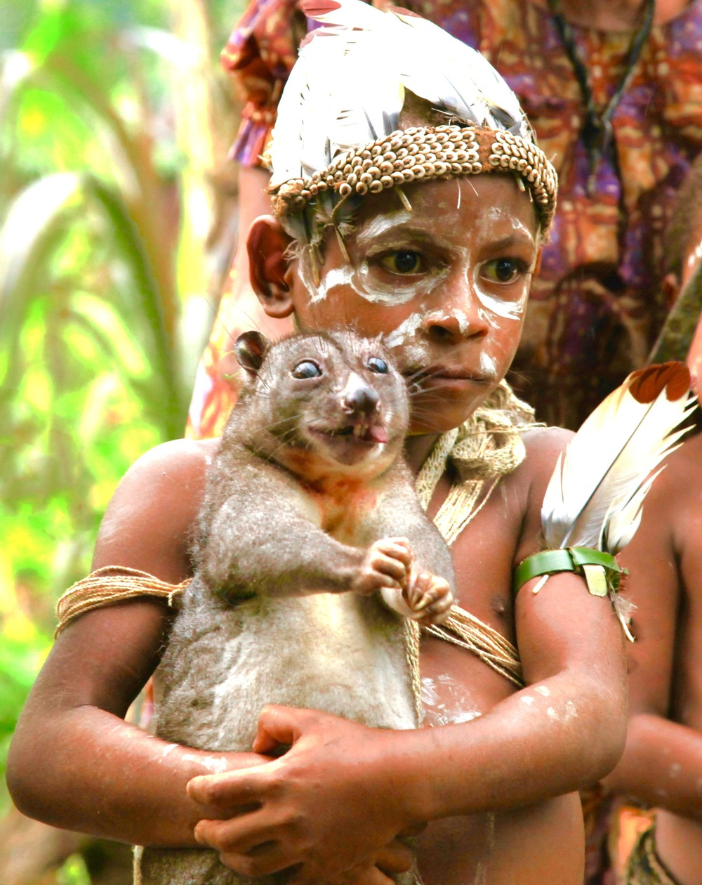 Kaluli Tribe Child Holding Cuscus-Papua New Guinea