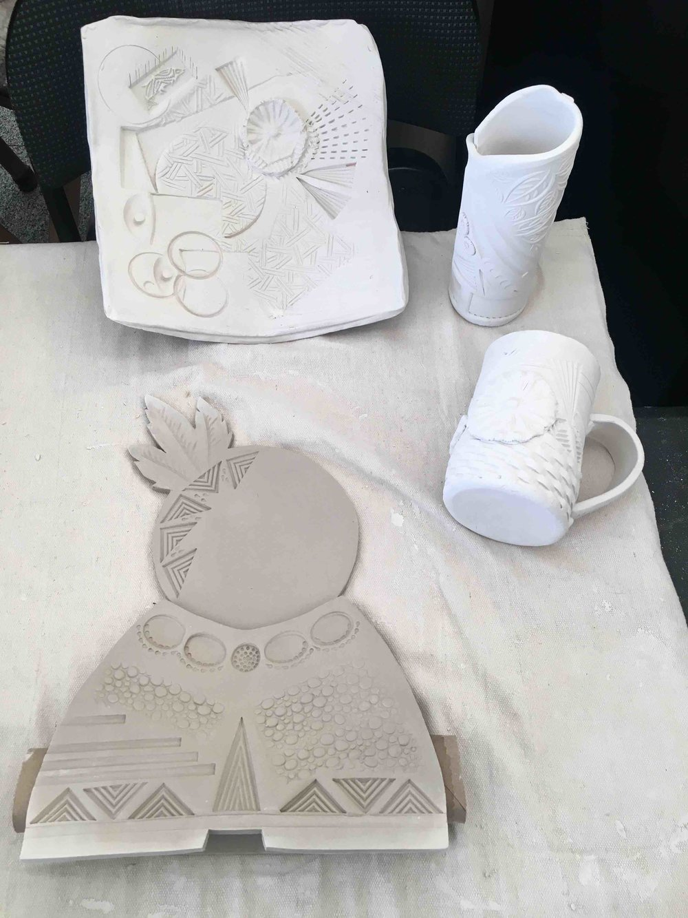 Ceramic tray, vase, cup and stand for a mask