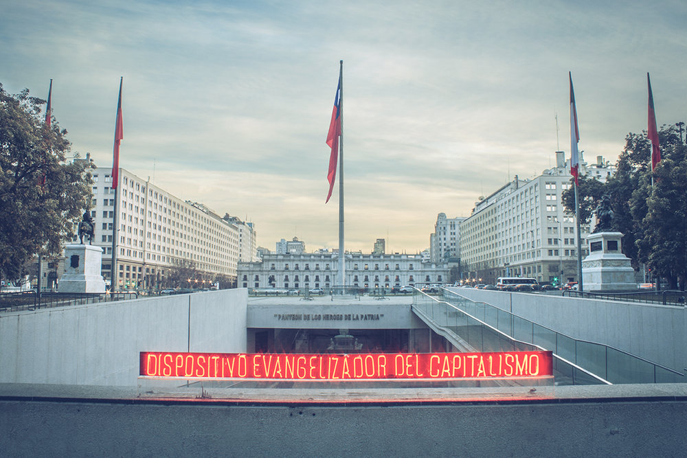 Neon installation in front of Chilean Government House 'La Moneda' or 'The Coin' | Santiago - Chile.