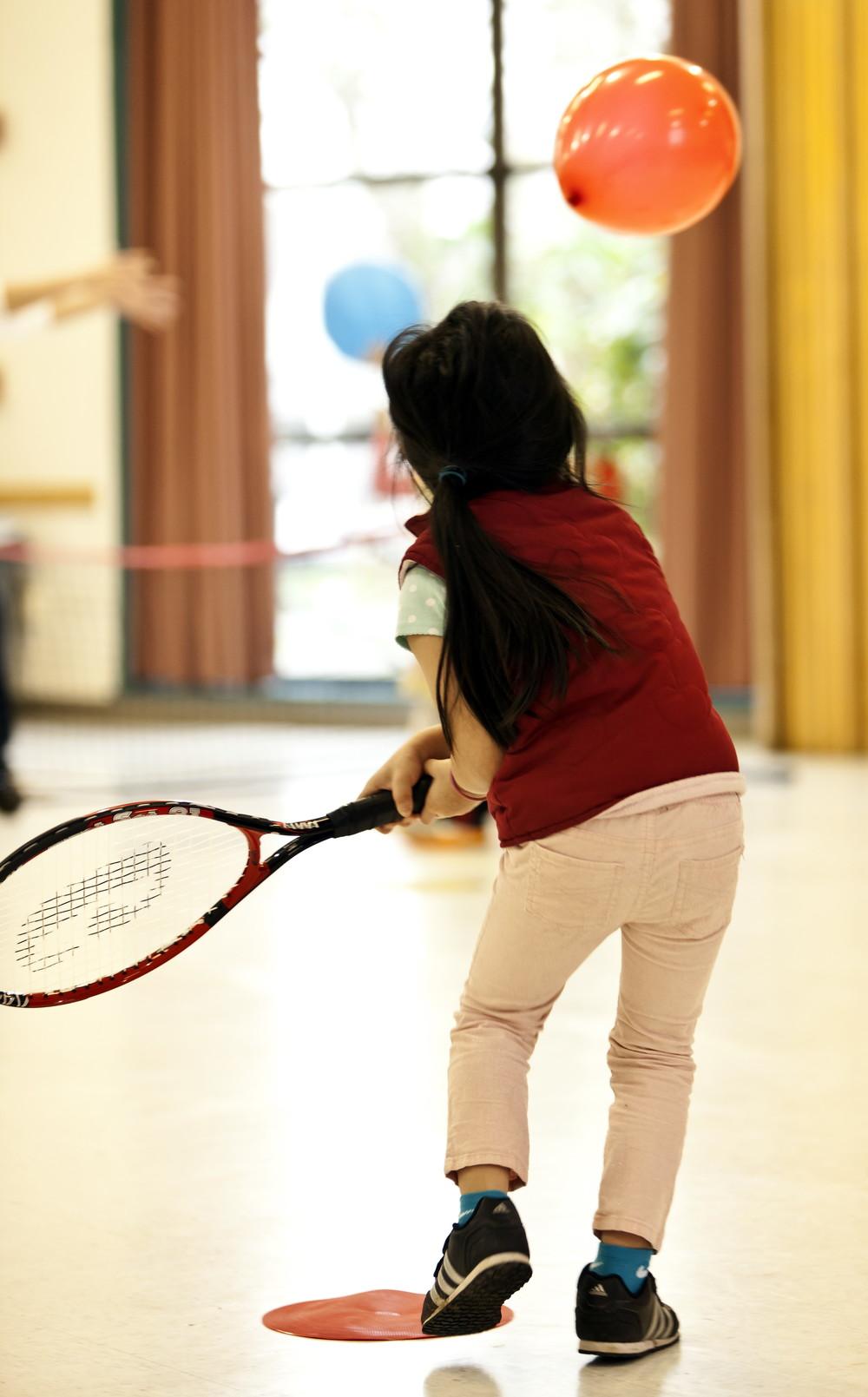 Girl swinging at balloon.jpg