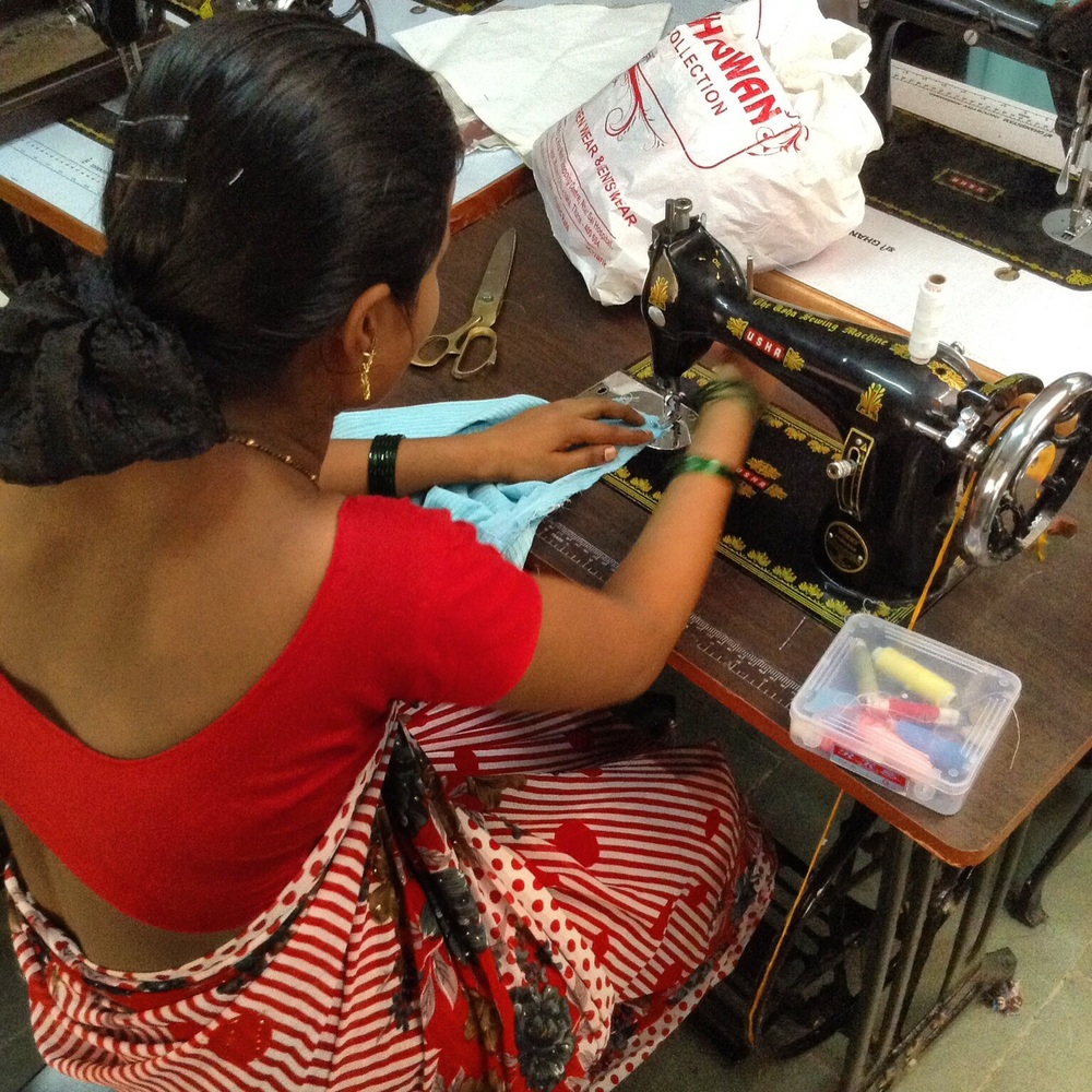 A young woman involved in CORP's educational program refines her sewing skills.