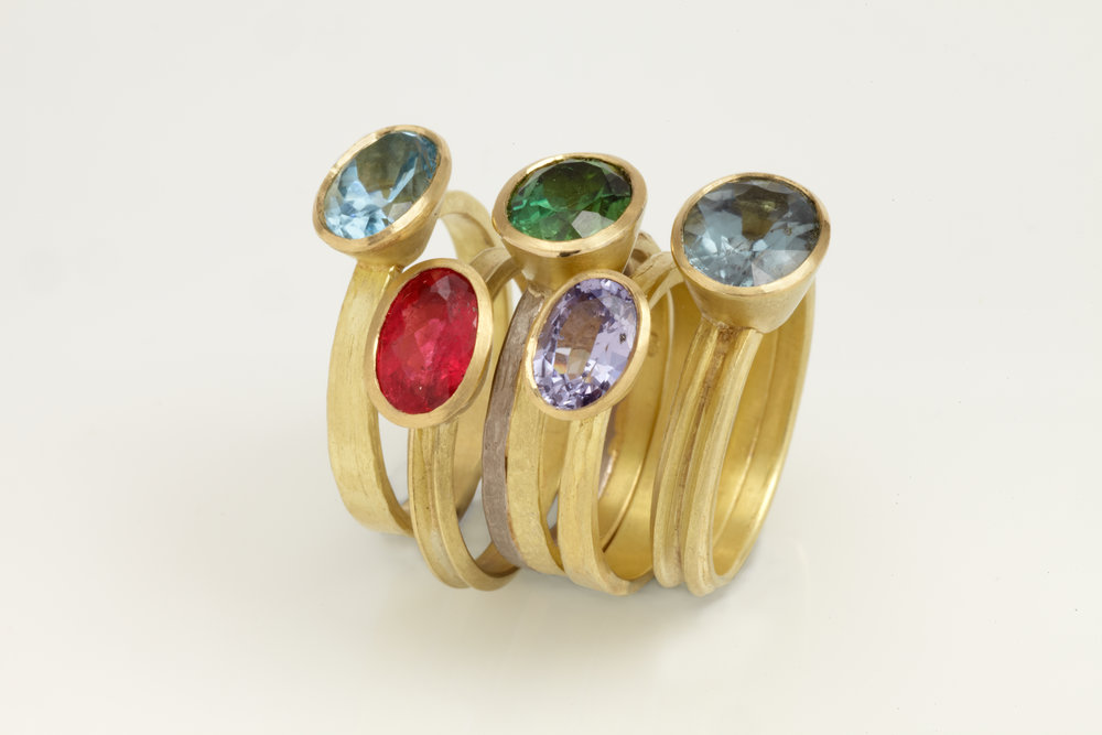 Gemset facetted stone rings in 18ct golds.jpg