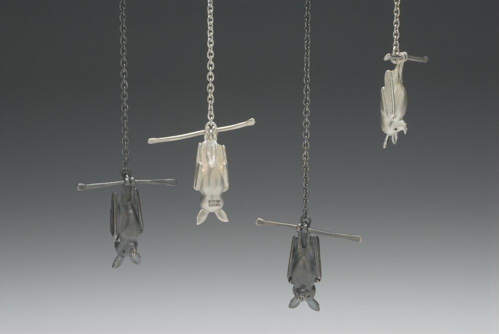 Bat at rest (pendants) size 25×10×8mm(Bat), 30mm(bar) silver, enamel paint
