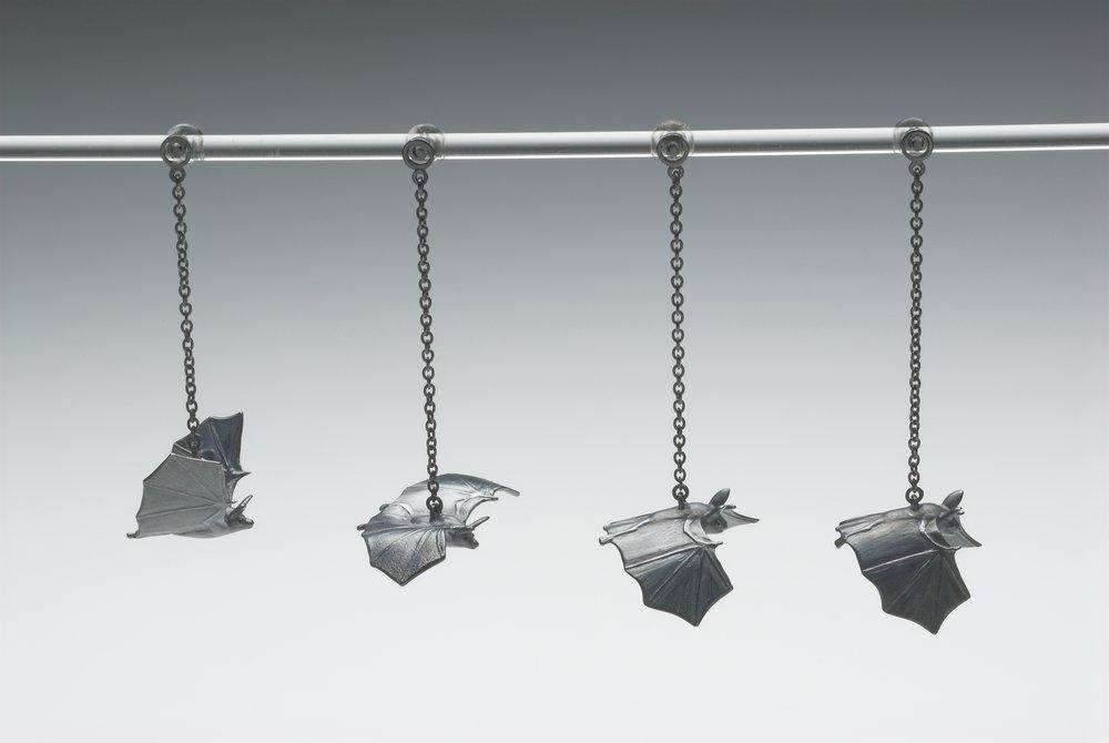 Bat Sequence (four earrings) size: 17x26x6mm, 16x30x5mm silver, enamel paint