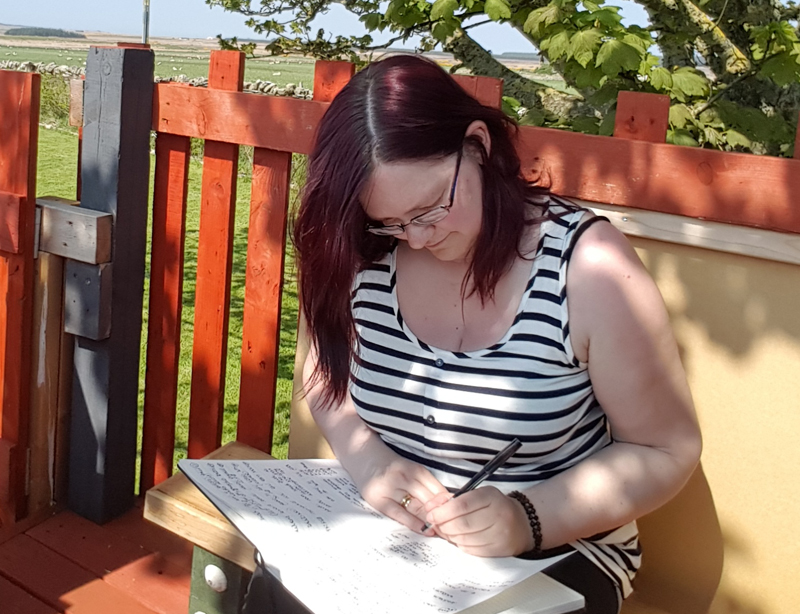 In my Happy Place; In my garden with pen and paper and the Sun shining!