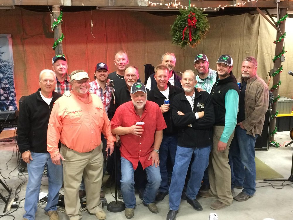 Christmas at Mike Harris Farms Pictured left to right are: Randy Hignite, Dennis Martin, Mike Harris, Tim Cifers, Delbert Armstrong Danny Garner, Kevin Armstrong, Johnnie Byrd, Jim Heidenreich, Dick Feyer, Chris Armstrong, Elliot Sadler, Will Arterburn.