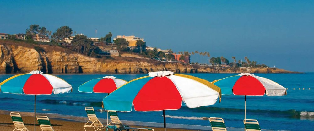 Umbrellas-on-beach-with-Cove.jpg