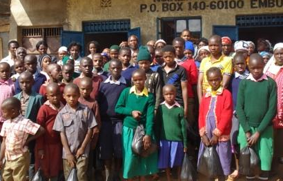 Orphaned children receive food assistance from Hugs for Life.