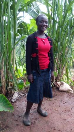 Jackline is 15. She is the second youngest of 10 children. She enjoys music and cooking.