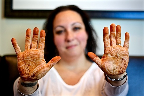 "Henna covering her hands like gloves, Marissa Gandelman had just returned from Kurukshetra, India. Recovering from the 10.5-hour time difference, her jet lag lingered, but talking with me about her massage therapy business, Elm City Wellness, perked her right up. This despite the fact that the room we were in, labeled ""Wind,"" was slow like syrup, with relaxing amber light. The sound of a gurgling stream came from one corner and flowing waves of spiritualist-approved, 432 Hz-calibrated music came from another. Click HERE to read the full story!"