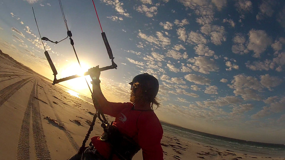 - What is land kiteboarding?Land kiting is using a mountainboard and power-kite to experience the thrill of kitesurfing on grass, dirt, or firm sand. Land kiting is a great alternative to traditional kitesurfing on water and is a sport in its own right.