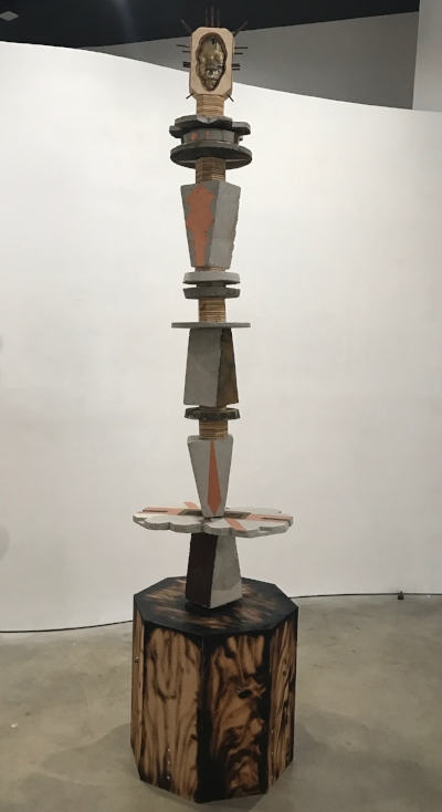 Anthony Suber,Mother Afmerika, 2017 concrete, wood, resin, oxidized metal, copper leaf 97 x 19 1/2 x 19 1/2 inches