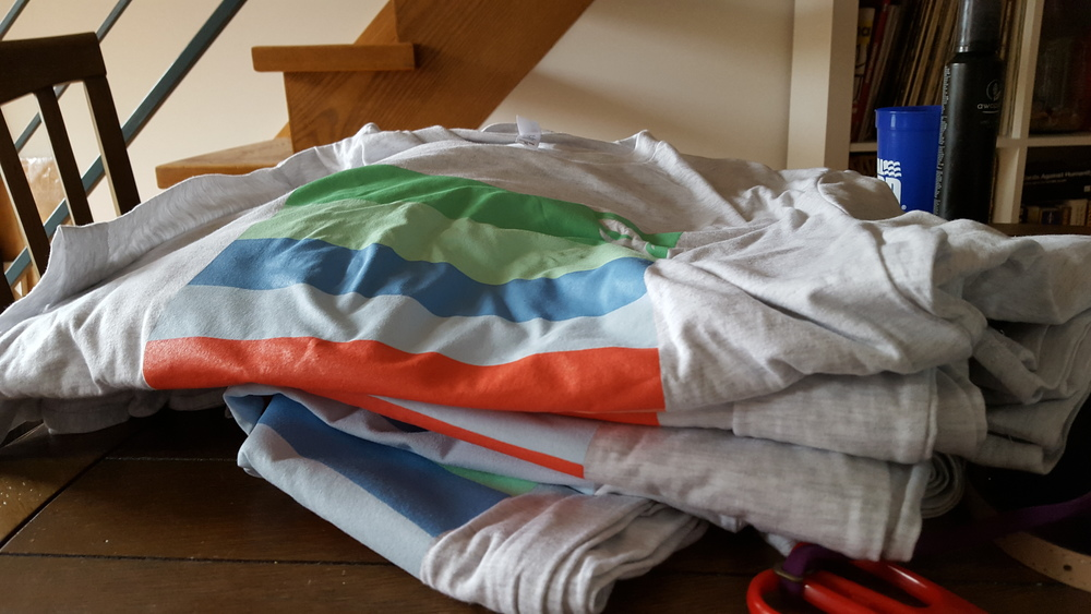 Our massive pile of shirts just picked up from the printer!