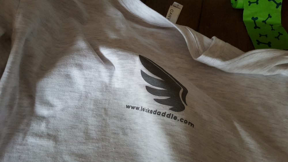 """Top back of the shirt has this small 4""""x4"""" logo with the url."""