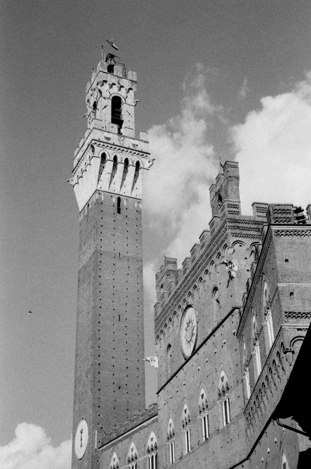 The clock-tower in the piazza del campo, at the center of Siena