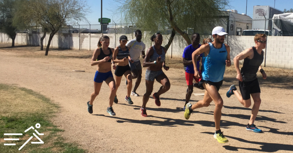 The late David Torrence (pictured in the light blue top) leads his Altis teammates + HPW's  Tara Welling  in a workout last March in Phoenix, AZ.