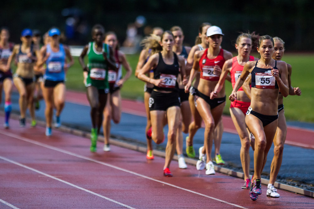 Tara Welling (#55) of High Performance West, racing up front and setting the tone at the 2016 Stumptown Twilight in the Women's 5,000m — photo ©  kevmofoto.com