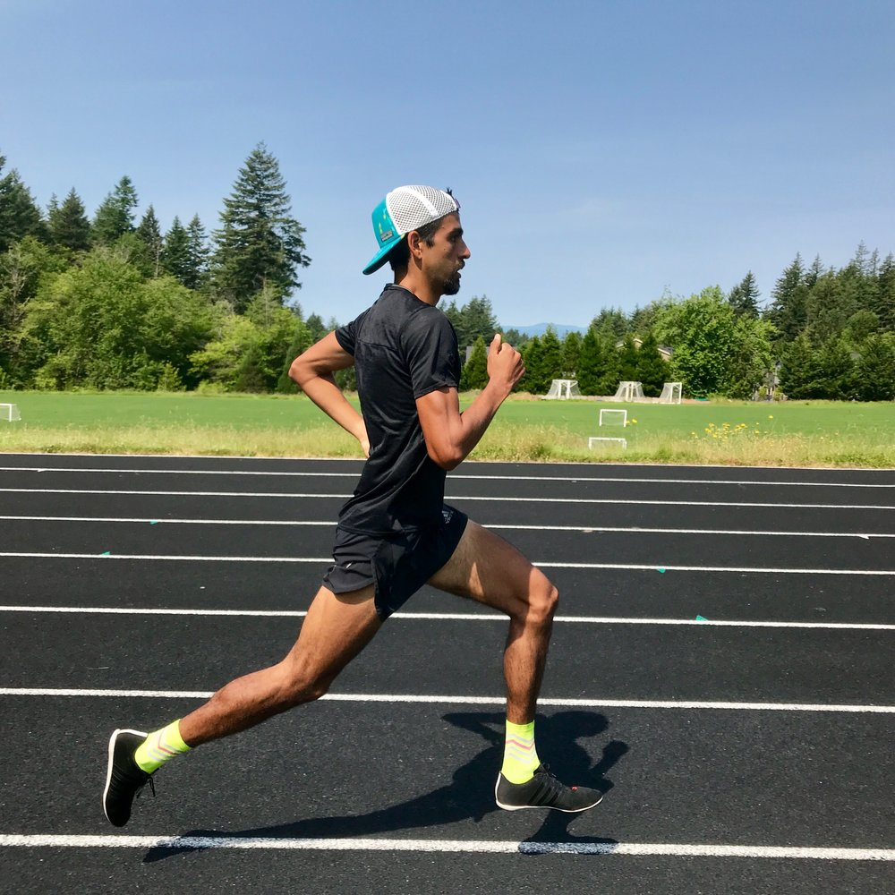 3:56 1 Mile man, Daniel Herrera mid-stride.