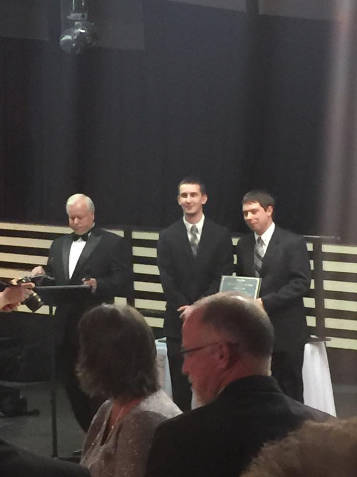 """Wade Rhodes presents Andrew and Preston with the Habersham Chamber of Commerce """"Entrepreneur of the Year"""" Award. -January 2015"""