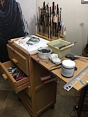 This is how my painting station looked at the end of work today. Time to clean up. Again!!!  Yes, I have lots of brushes available for quick access. And my palette knives are attached to the far end of my taboret…