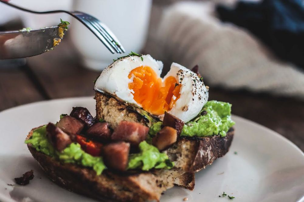 smashed avocado on toast with a boiled egg from Salon Brixton