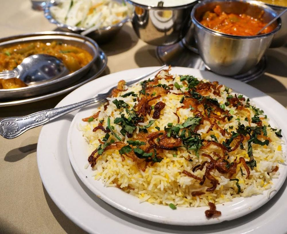 meat biryani with vegetable curry from Halal Restaurant