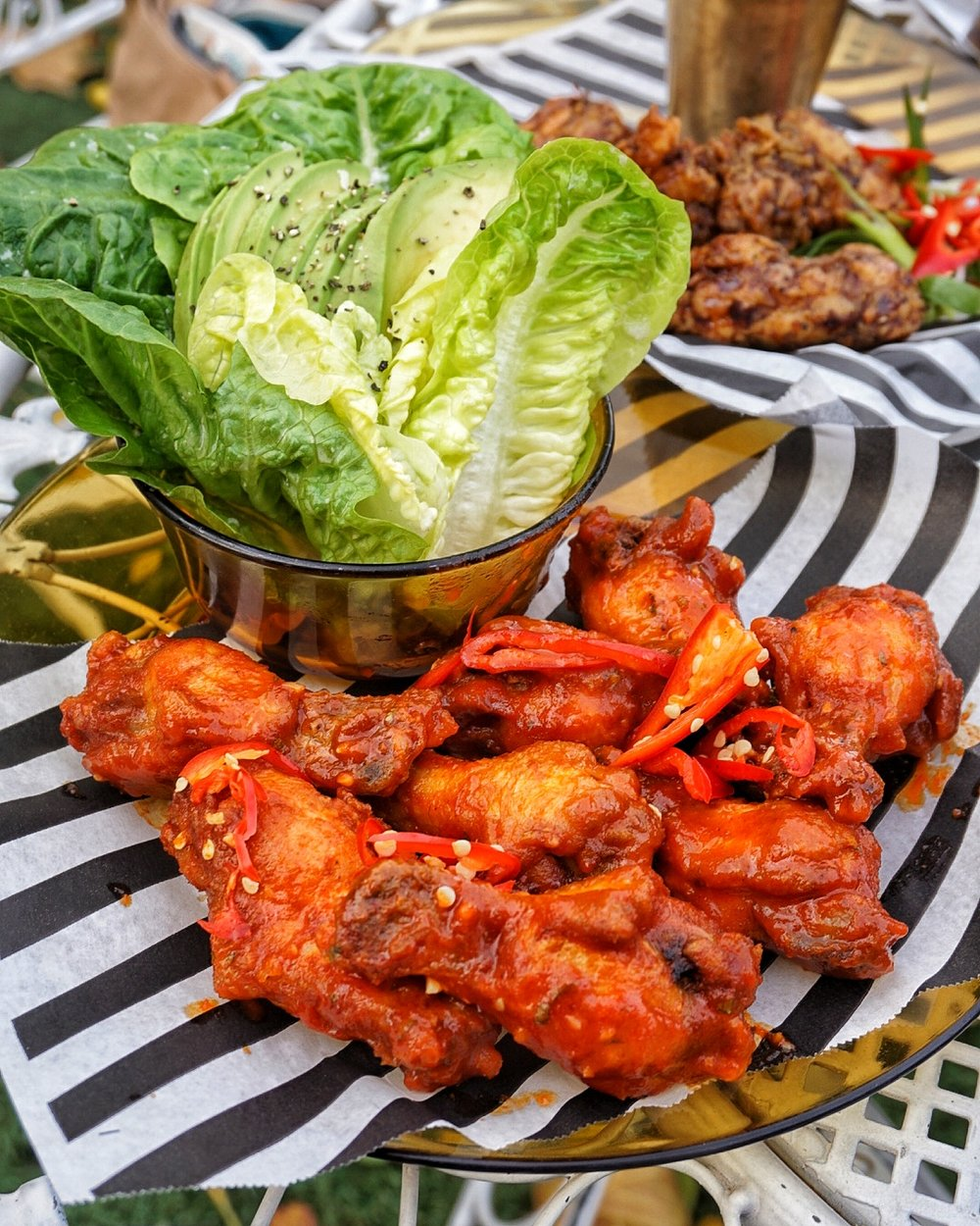 Wings with lime leaf salad and avocado