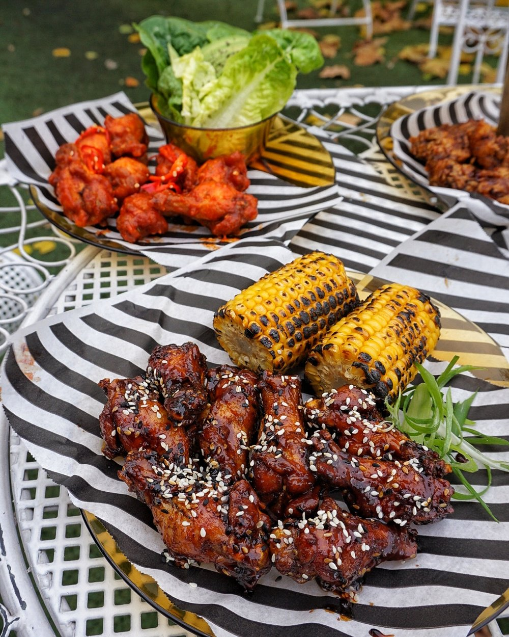 Wings with roasted corn, and lime leaf salad with avocado