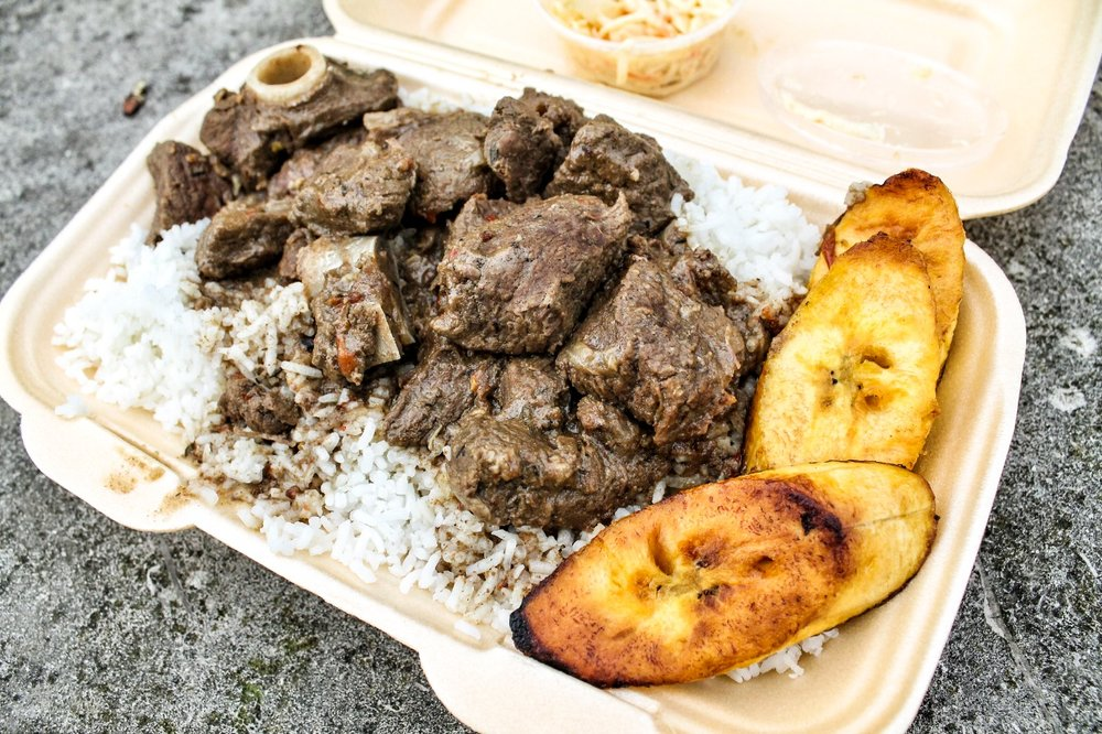 curried goat with rice and plantain, Trev's Flavas