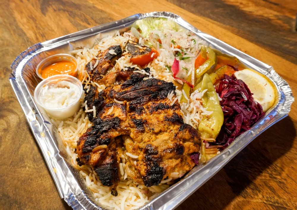charcoal grilled chicken with rice and salad, from Beirut Canteen in New Cross