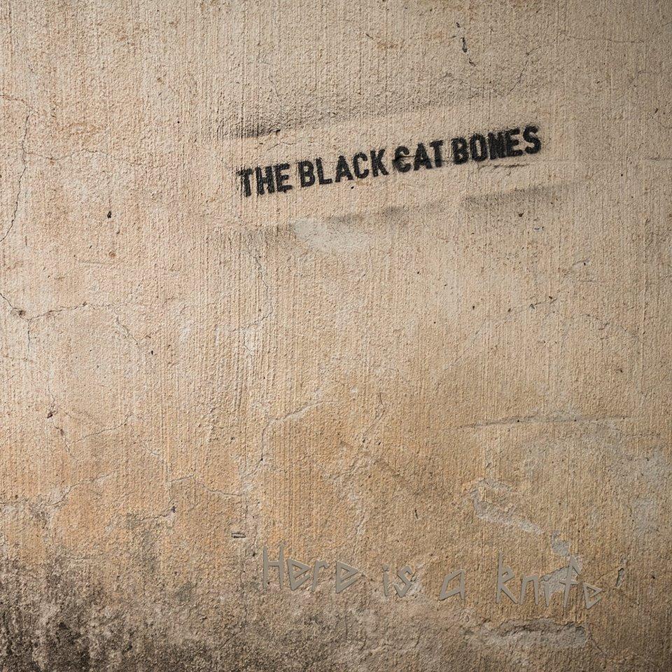 The-Black-Cat-Bones-Here-Is-A-Knife