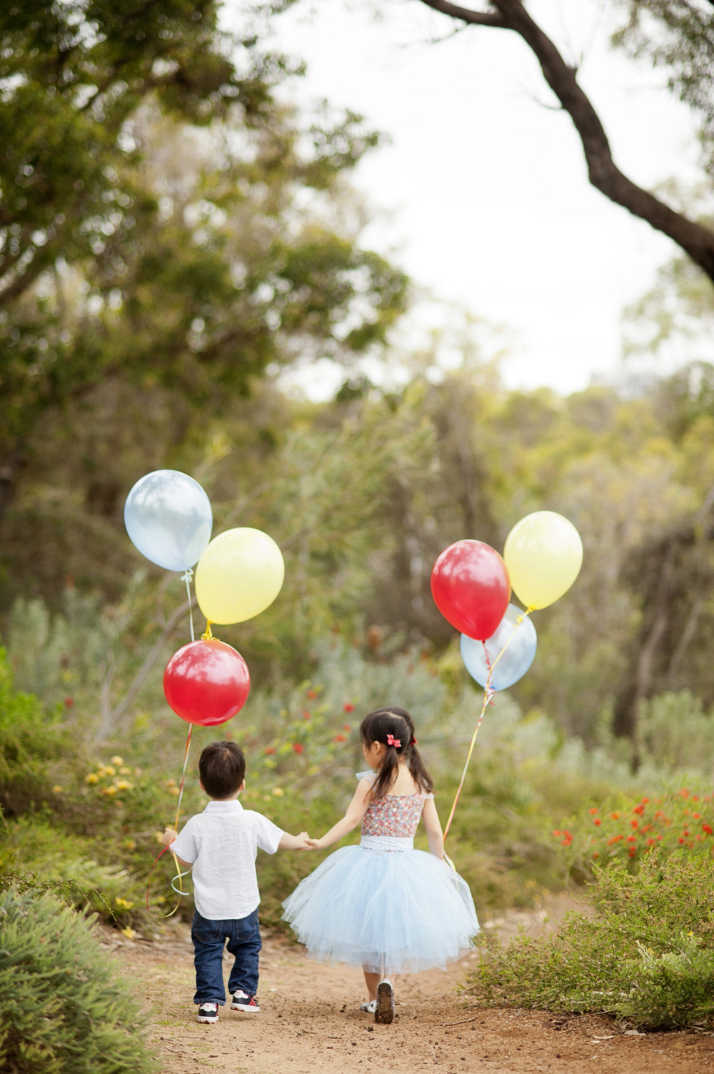 cute kids with helium balloons portrait photo shoot