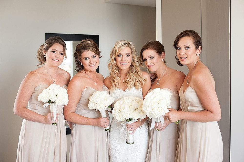 08_bride with bridesmaids in neutral tones wedding perth.jpg