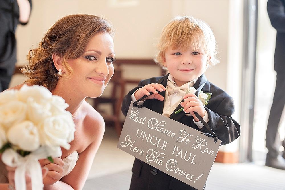 15_cute page boy with chalkboard sign wedding perth.jpg