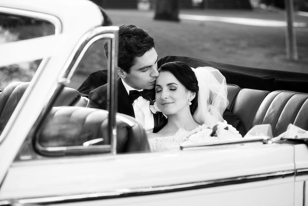 77_bride and groom in convertible vintage car wedding perth.jpg
