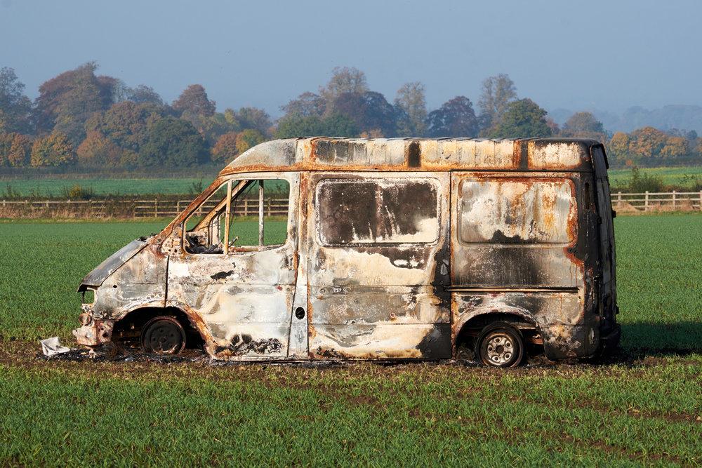 Van in field