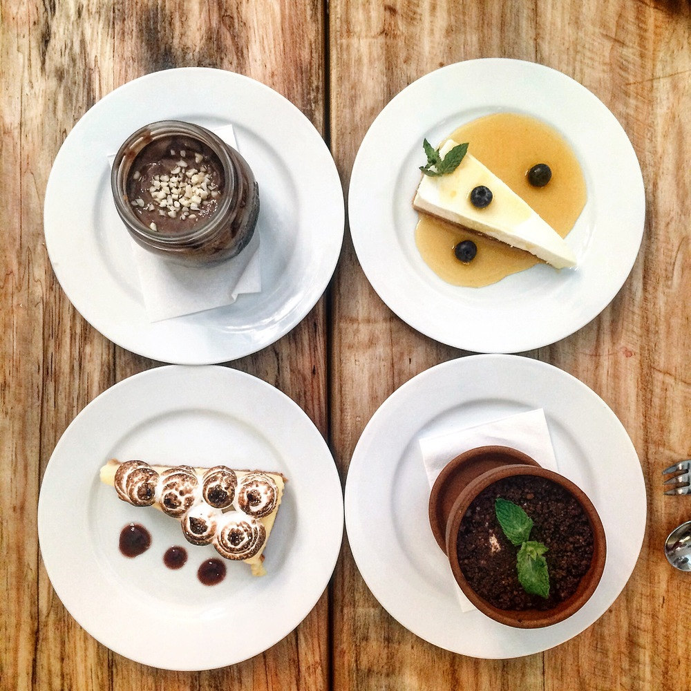 Desserts: cheese cake with passion fruit, lemon meringue pie, tiramisu and chocolate mousse at Santa Gula, Barcelona