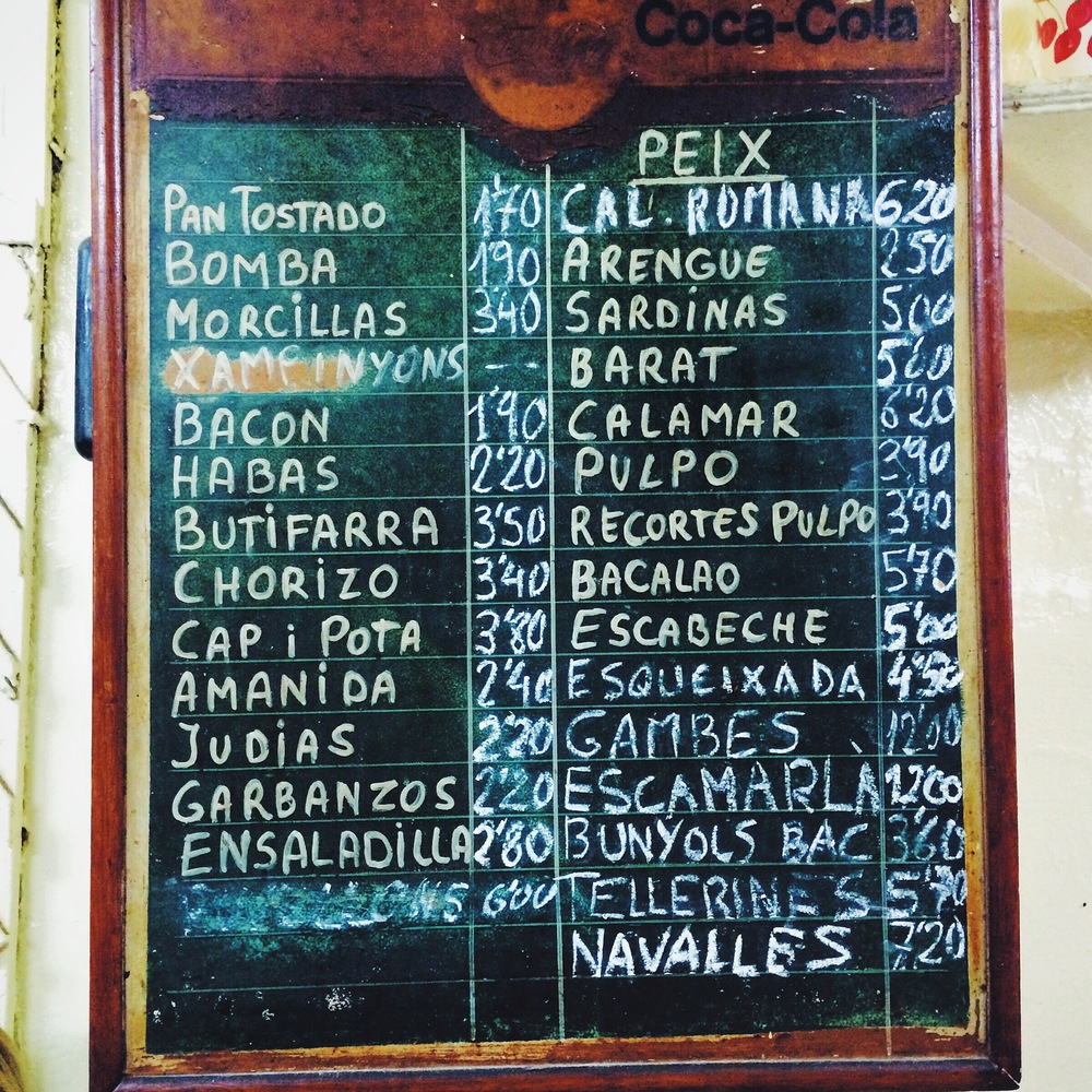 Menu on a black board at La Cova Fumada, Barcelona