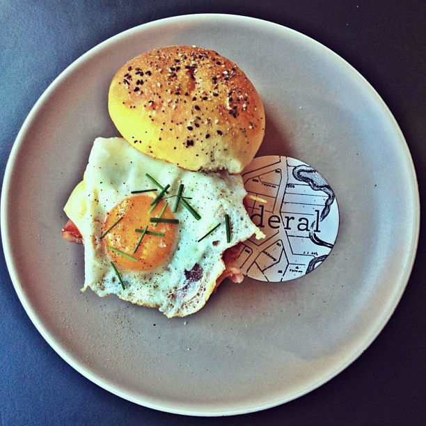 Hamburger with bacon and a fried egg, sunny side up: Federal Café Barcelona.