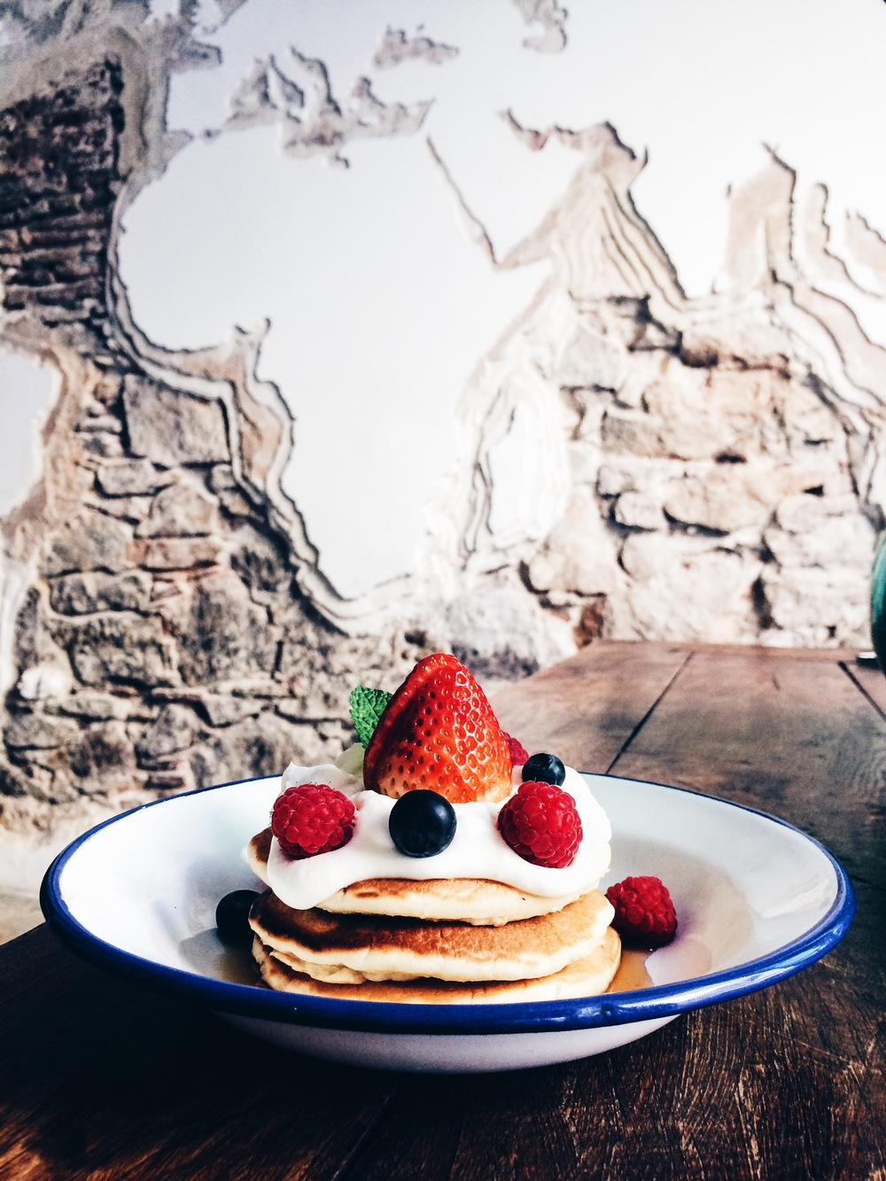 Pancakes with cream cheese frosting, berries and maple syrup at Tropico, Barcelona