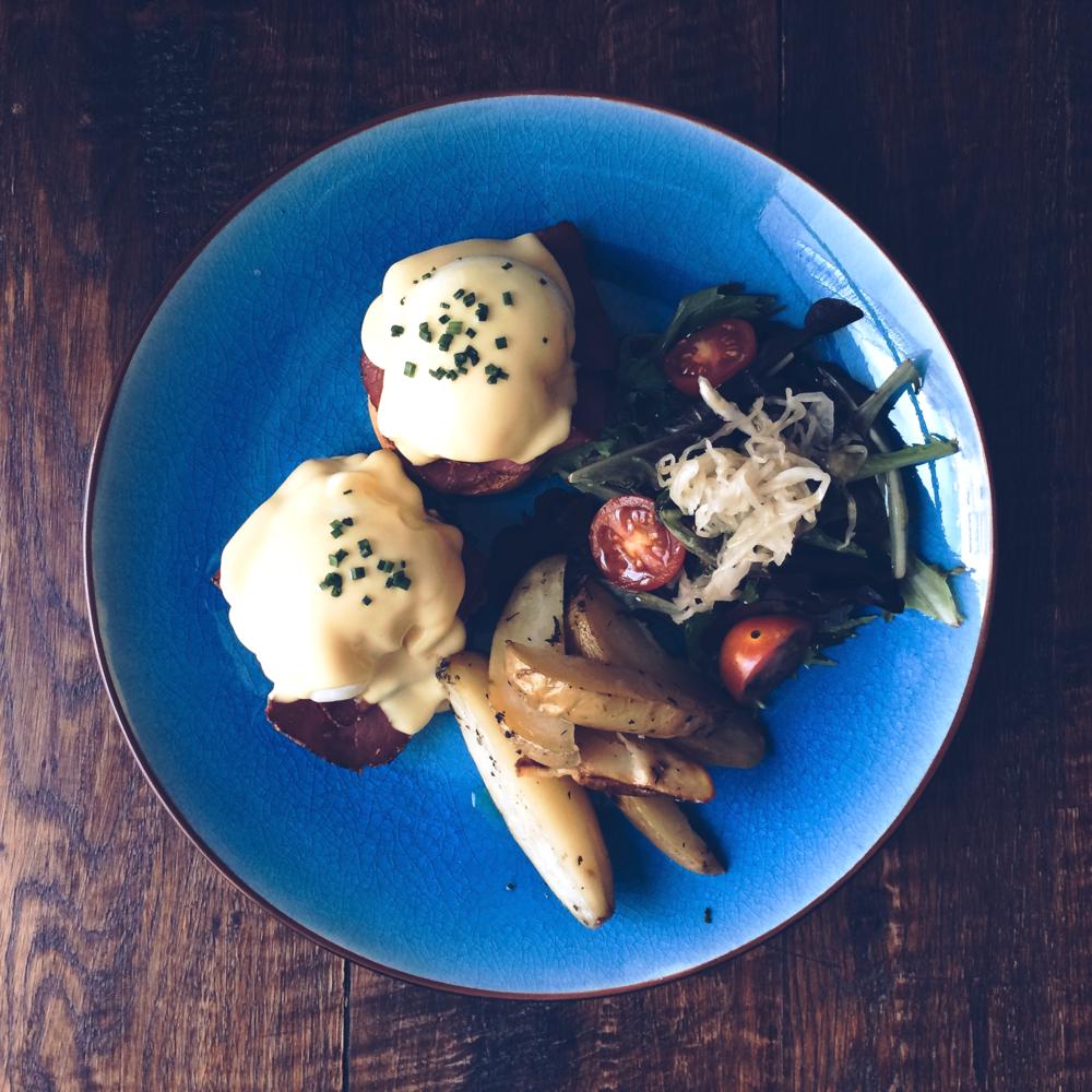 Eggs Benedict with pastrami, potatoes and sauerkraut at Tropico, Barcelona