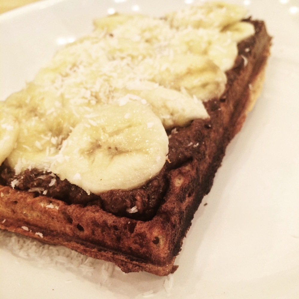 Gluten free, sugar free vegan waffle with rawtella, banana and coconut at Väcka.