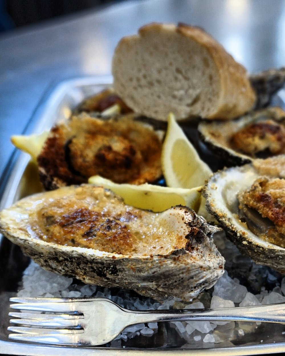 Chargrilled oysters at St Roch Market, New Orleans